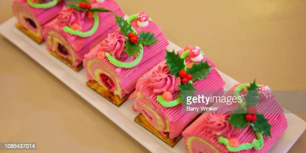 pink christmas log - yule log stock pictures, royalty-free photos & images