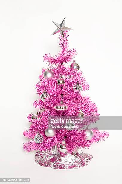 Pink Christmas tree on white background