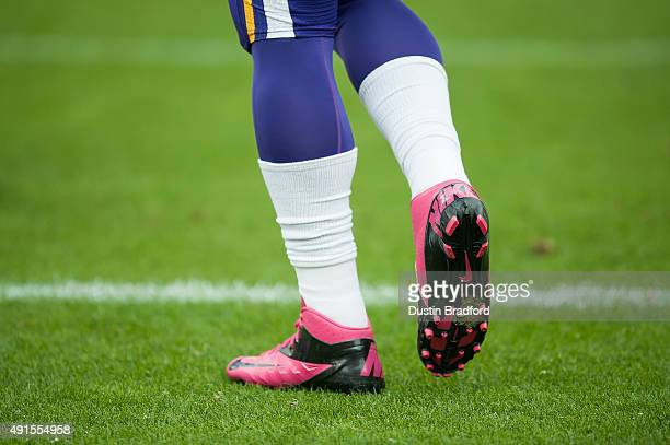 Pink cleats designed to promote breast cancer awareness seen on a Minnesota Vikings player before a game against the Denver Broncos at Sports...