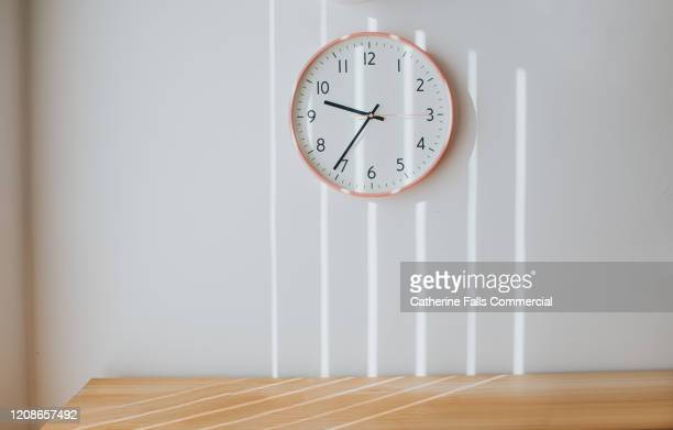 pink clock - wall clock stock pictures, royalty-free photos & images