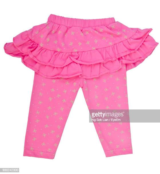 pink clothing over white background - pink pants stock pictures, royalty-free photos & images