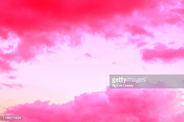 pink cloud background - zachtroze stockfoto's en -beelden