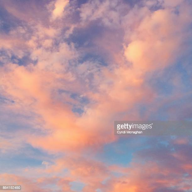 pink clouds and blue sky - moody sky stock pictures, royalty-free photos & images