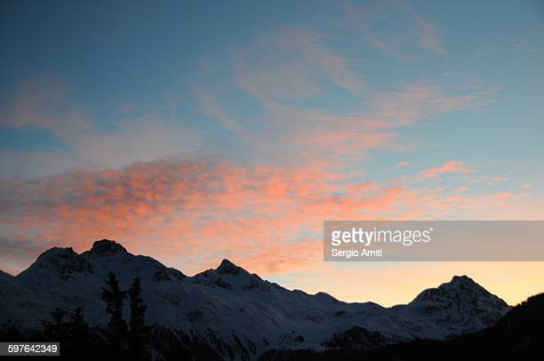 Pink clouds over the Alps at sunrise
