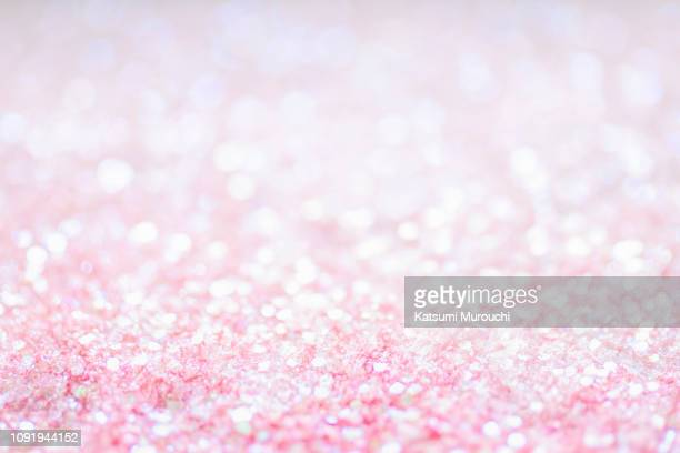 pink color glitter texture background - ピンク色 ストックフォトと画像