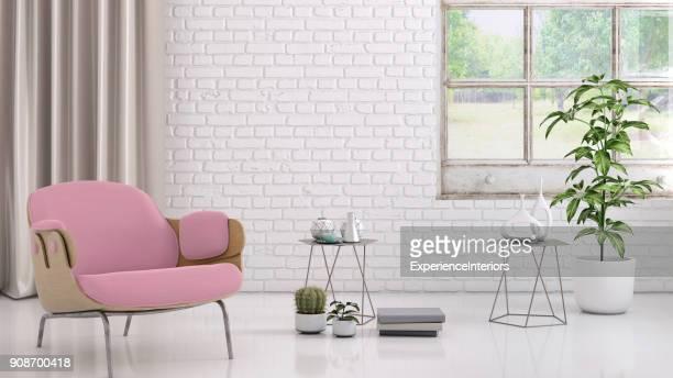 Sillón color rosa con flores, mesa de centro y plantilla de pared en blanco