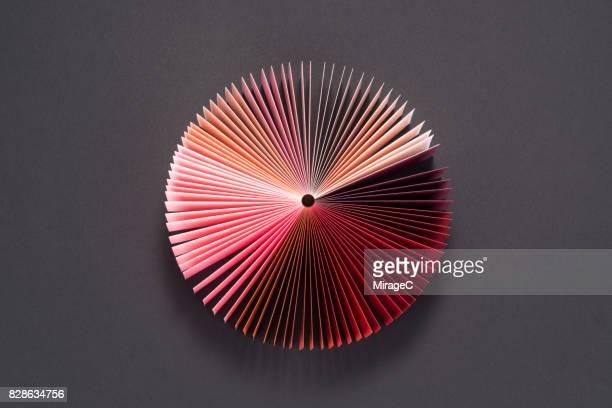 pink colored book pages pie chart - finanzas y economía fotografías e imágenes de stock