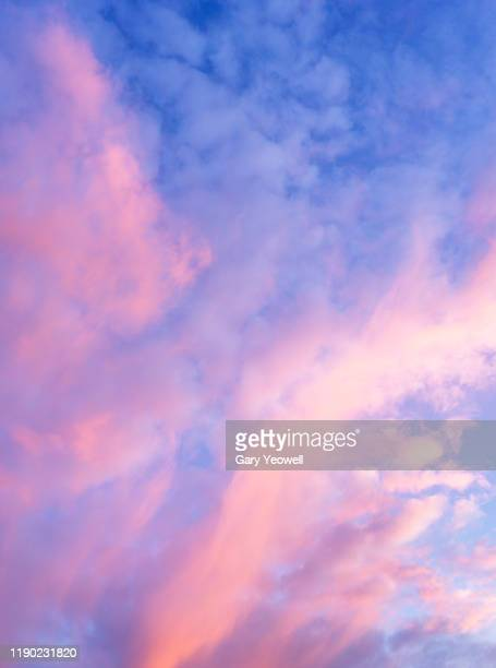pink colored clouds at sunset - sky stock pictures, royalty-free photos & images