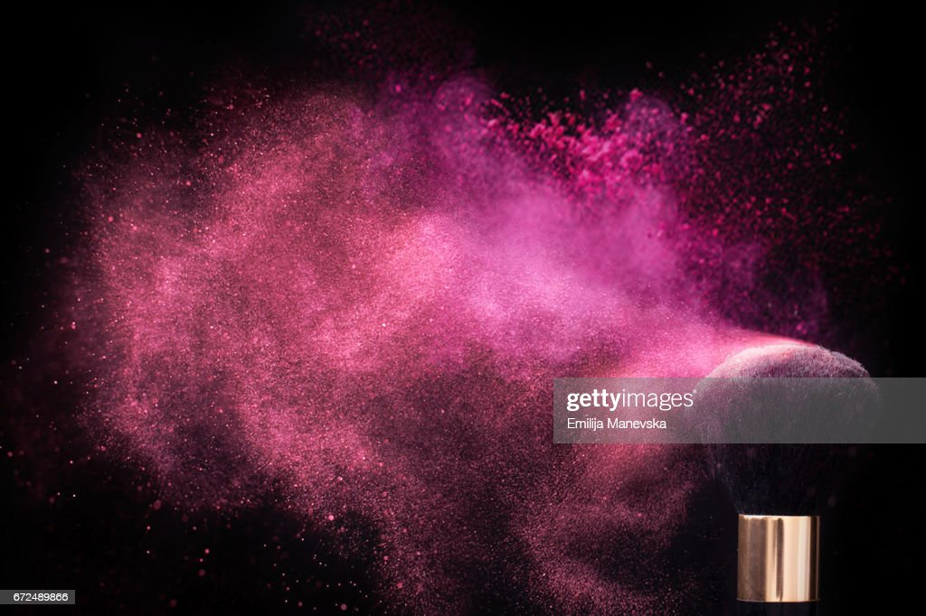 Pink colored face powder exploding : Stock Photo