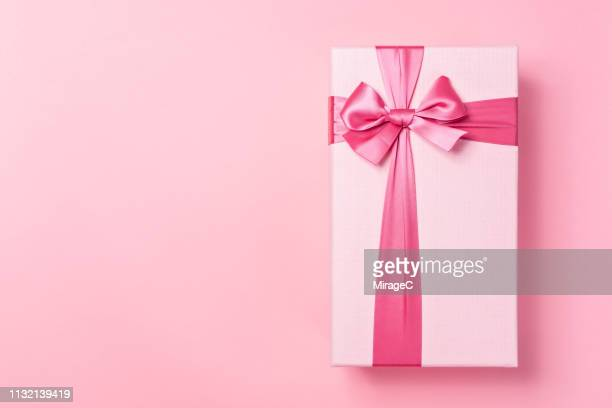 pink colored gift box on pink - anniversary stock pictures, royalty-free photos & images