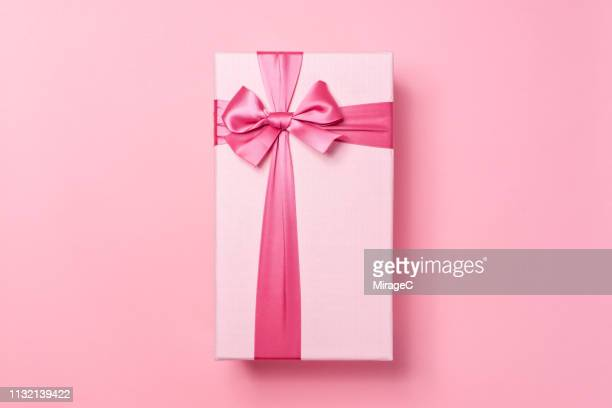 pink colored gift box on pink - birthday present stock pictures, royalty-free photos & images