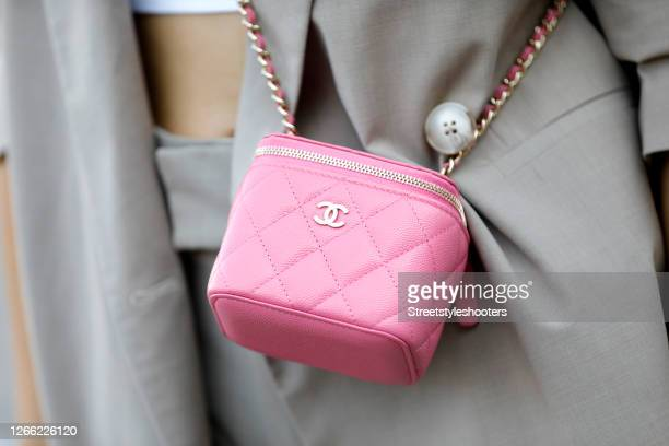 Pink colored mini bag by Chanel as a detail of influencer Jacqueline Zelwis during a street style shooting at Copenhagen Fashion Week Spring/Summer...