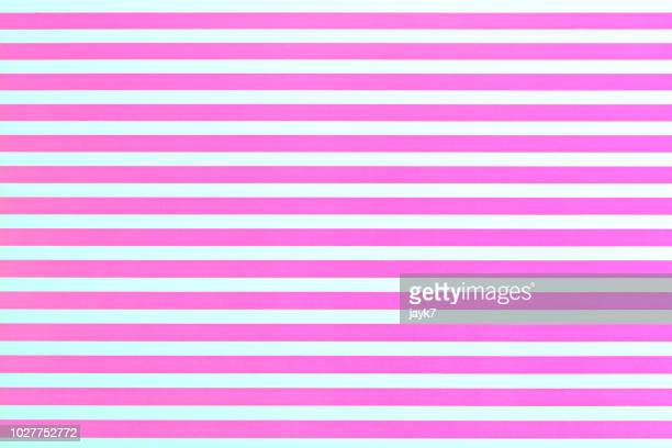 pink colored paper background - listrado - fotografias e filmes do acervo