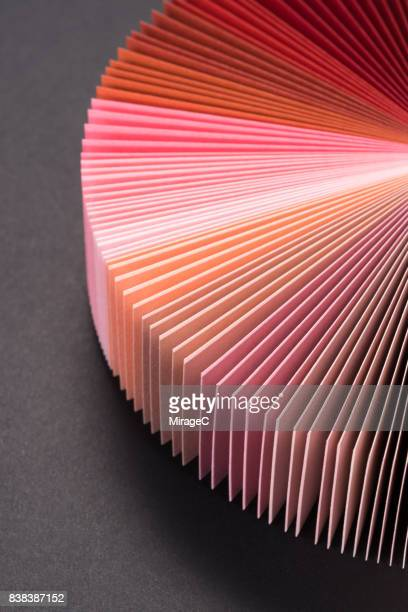 Pink Colored Paper Cards Fan Out Shape