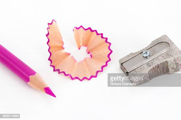 Pink coloring pencil , sharpener and shaving