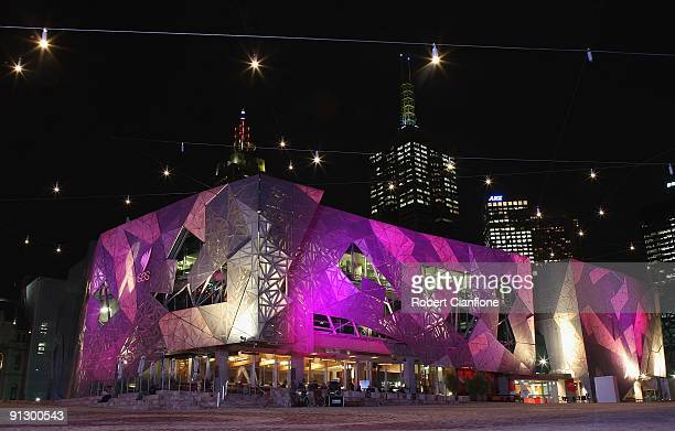 Pink coloured lighting is lit up onto buildings at Federation Square on October 1, 2009 in Melbourne, Australia. Federation Square will be...