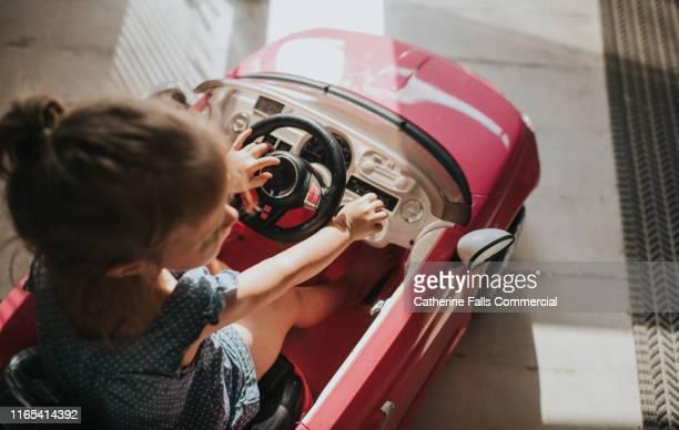 pink convertible car - ジェンダー・ステレオタイプ ストックフォトと画像