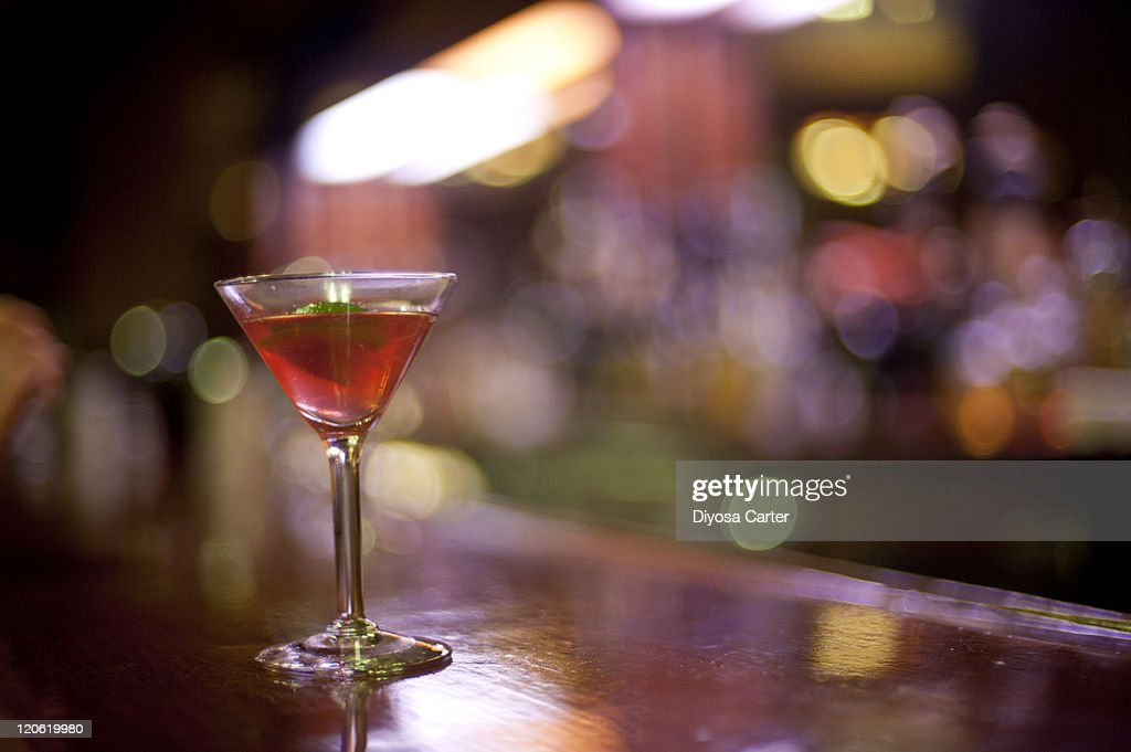 Pink cosmopolitan on bar counter : Stock Photo