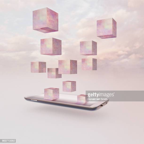 Pink cubes rising out of mobile phone into sky