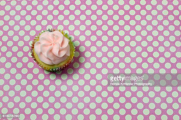 Pink Cupcake on a Pink and White Polka Dot background