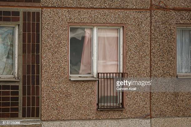 A pink curtain hangs in front of the window of the apartment where hours earlier police arrested Syrian terror suspect Jaber AlBakr on October 10...