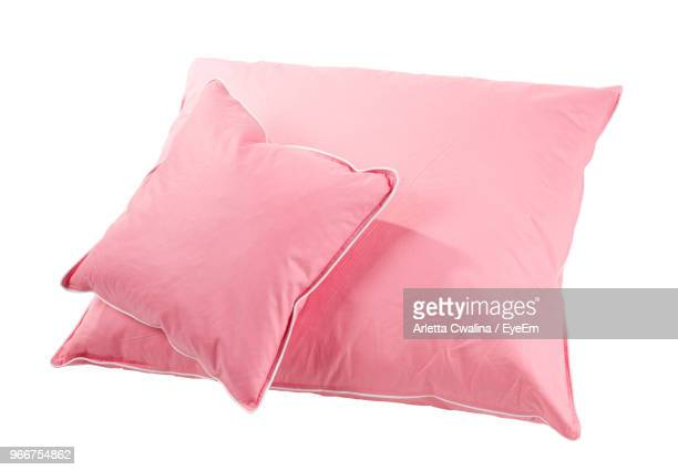 pink cushions on white background - cushion stock photos and pictures