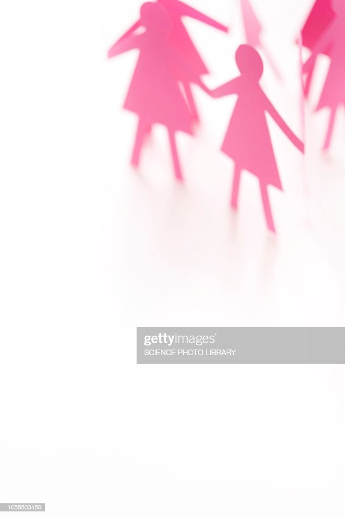 Pink cut out paper chain female figures : Stock-Foto