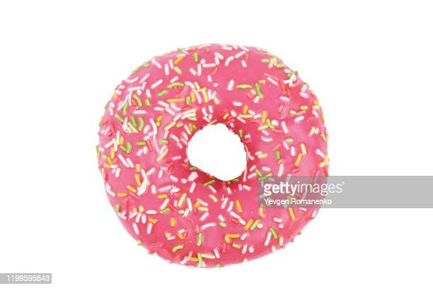 pink donut with colourful sprinkles isolated on white background. top view. - ドーナツ ストックフォトと画像