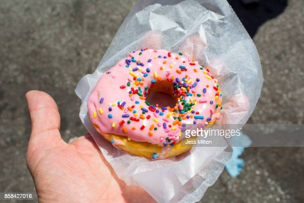 Pink donut with rainbow sprinkles