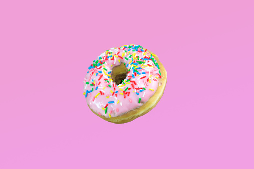 Pink donuts with colorful toppings. - gettyimageskorea