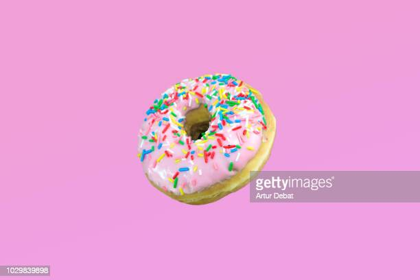 pink donuts with colorful toppings. - donut stock pictures, royalty-free photos & images