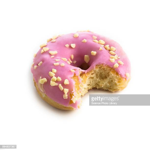 pink doughnut with missing bite - missing bite stock photos and pictures