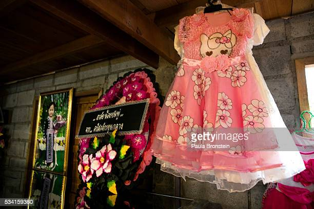 A pink dress is seen next to the coffin of Chomphu age 8 during a memorial service in the Hmong community of Jom Thong Chiang Mai province May 25...