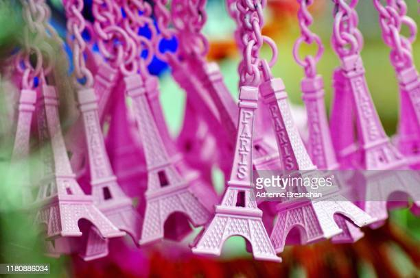 pink eiffel tower keychains - souvenir stock pictures, royalty-free photos & images