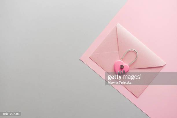 pink envelope with a pink lock with a password. - confession law stock pictures, royalty-free photos & images