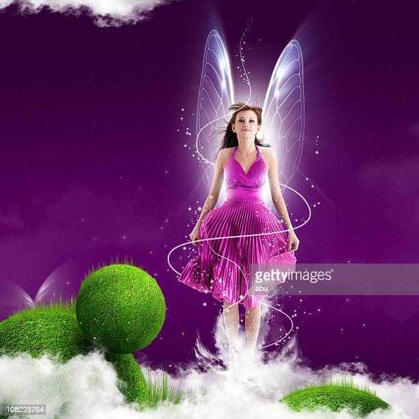 pink fairy woman on purple background - fairy stock photos and pictures