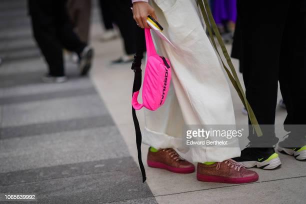 A pink fanny pack bag outside Issey Miyake during Paris Fashion Week Menswear SpringSummer 2019 on June 21 2018 in Paris France