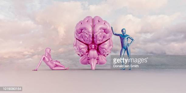 Pink female figure reclines on ground as blue male figure leans against pink brain
