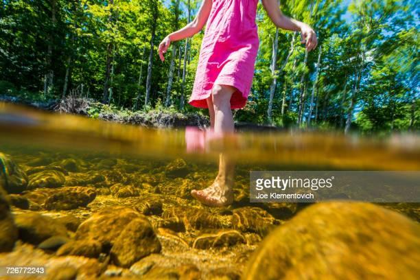 Pink flip flops in the river