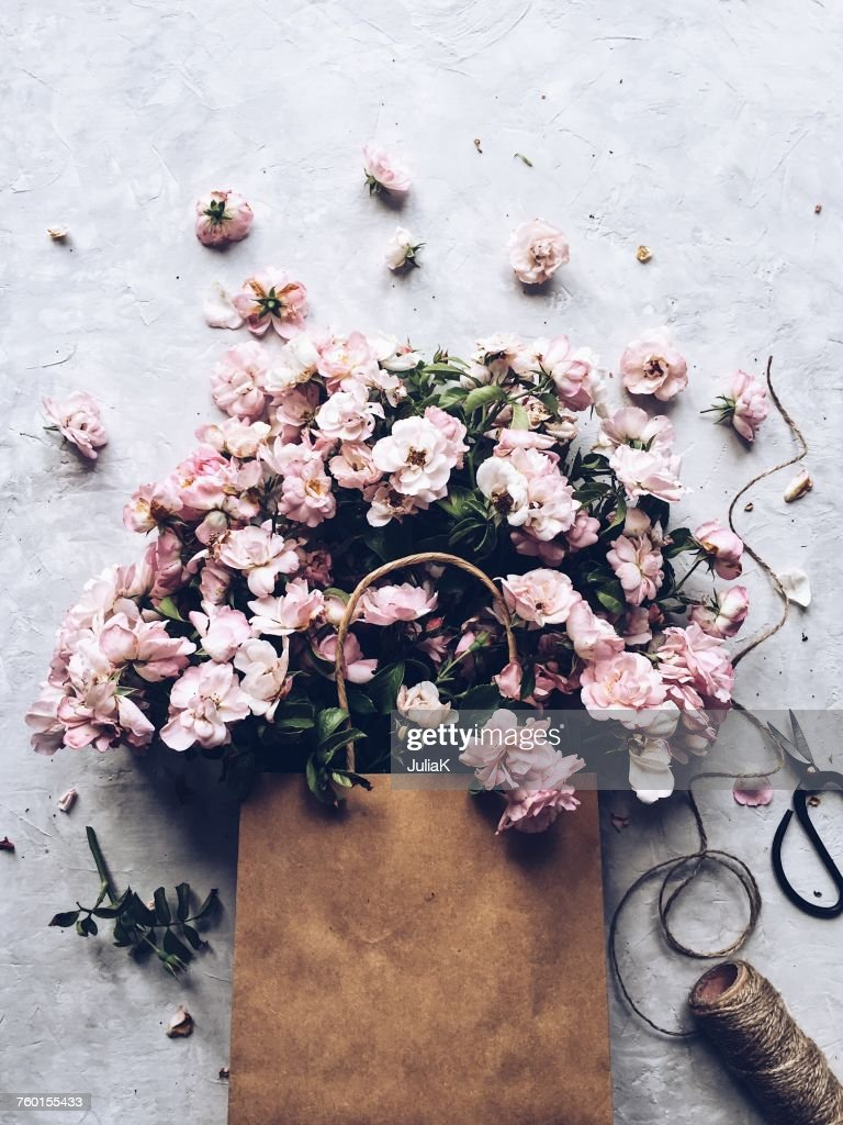Pink flowers in a paper bag : Stock Photo