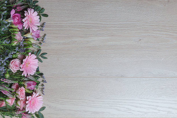Pink Flowers Over Wooden Background