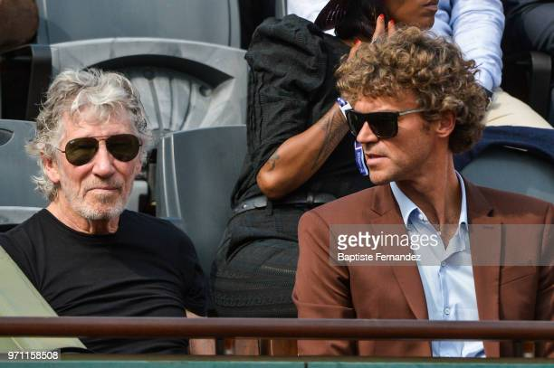 Pink Floyd bassist and singer Roger Waters former tennis player Gustavo Kuerten during Day 15 for the French Open 2018 on June 10 2018 in Paris France