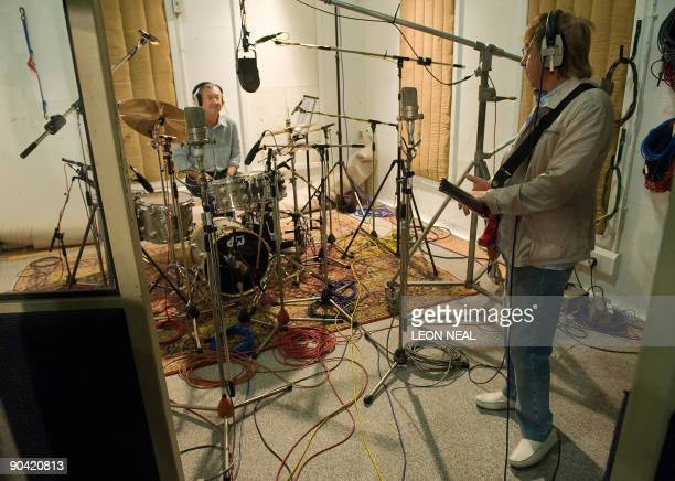 Pink Floyd drummer Nick Mason and former Rolling Stone Bill Wyman take part in a charity recording of a Children in Need album at Abbey Road studios...