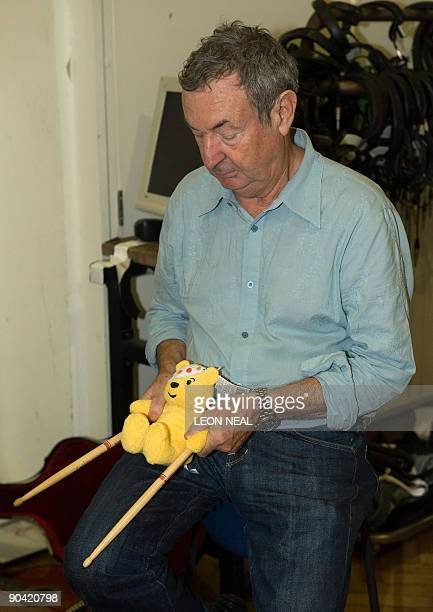 Pink Floyd drummer Nick Mason poses for photos before taking part in a charity recording of a Children in Need album at Abbey Road studios in west...