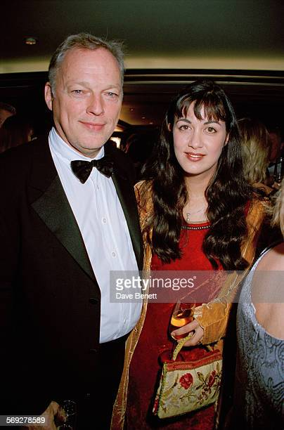 Pink Floyd guitarist David Gilmour and his wife English novelist Polly Samson attending the British Book Awards at the London Hilton February 1999
