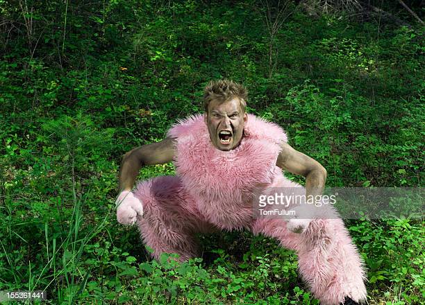 pink furry man - hairy man stock pictures, royalty-free photos & images