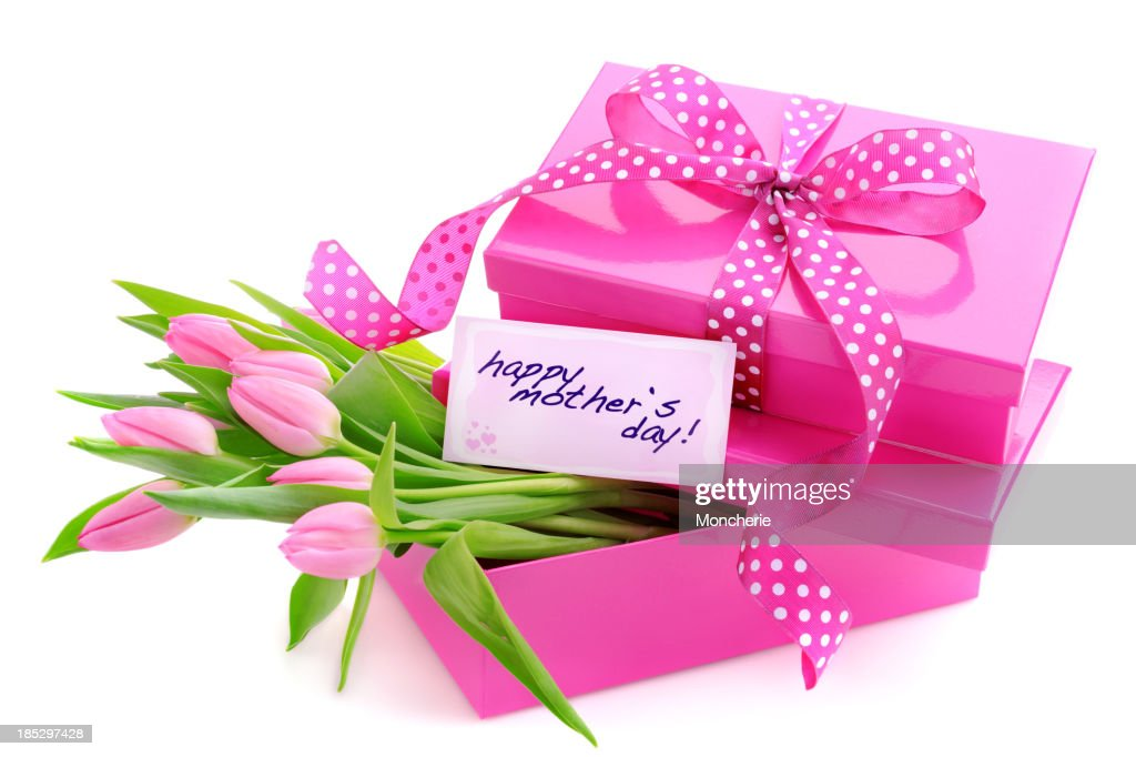 Pink gift boxes with a mothers day card and tulips : Stock Photo