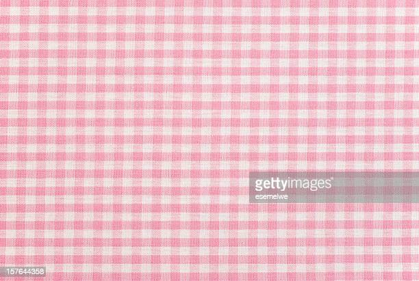 A pink gingham pattern fabric background