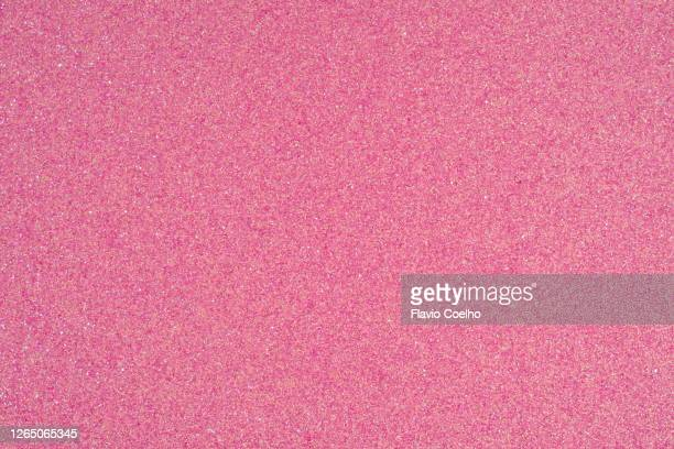 pink glitter surface background - pink colour stock pictures, royalty-free photos & images