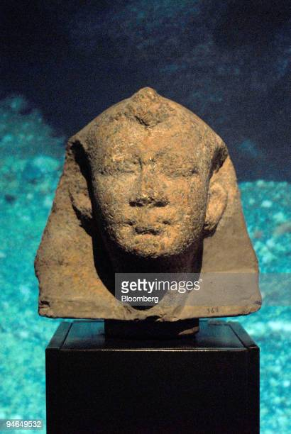 Pink granite head of a Ptolemaic king is on display in a room devoted to underwater archaeological discoveries at the Alexandria National Museum in...